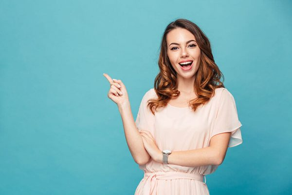 Young woman smiling and pointing